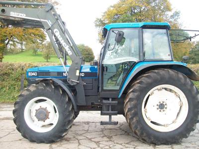 NEW HOLLAND 8340 with Quicke Q970 loader